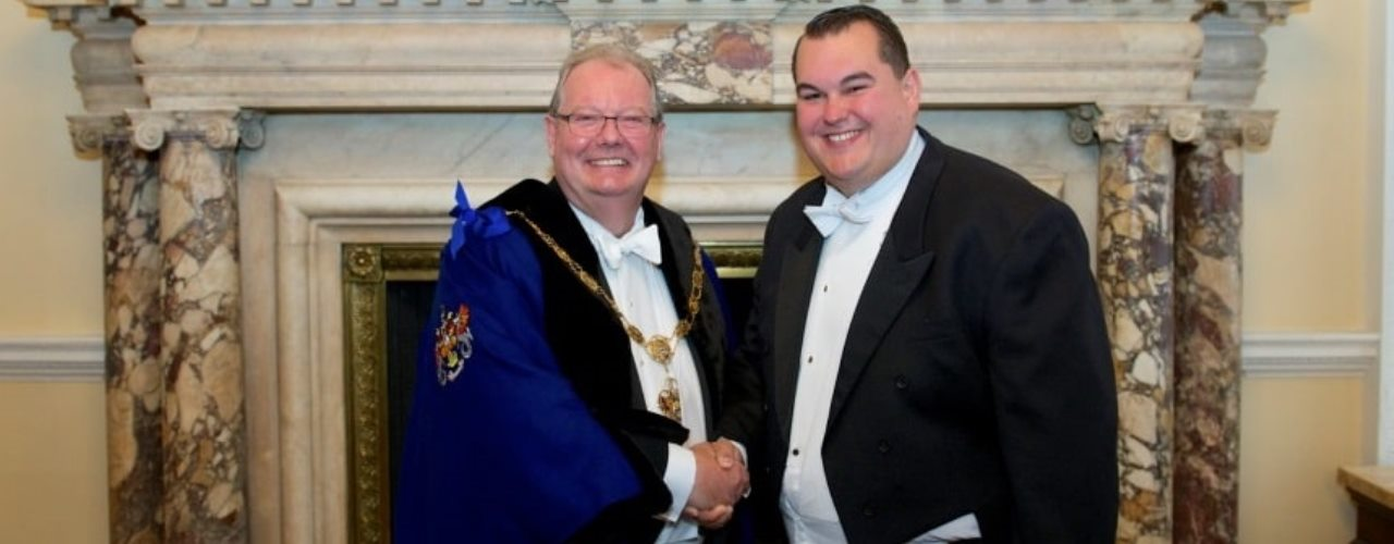 Steve Pailthorpe shaking hands with The Master of The Worshipful Company of Marketors